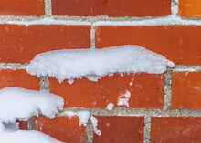 Snow Stuck To The Wall Of A Re...