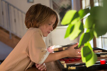 4 Year Old Boy Playing Board G...