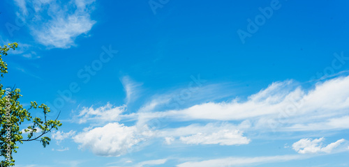 african stock photo of white clouds in a crisp blue sky Fototapet