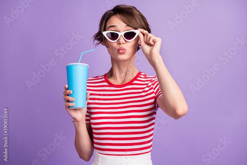 Fotografie, Obraz Photo of charming lady hold specs soda plastic takeaway cup send air kiss wear s