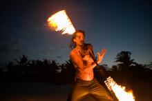 Man Spinning A Fiery Baton