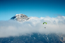 Paragliding In The Alps Over The Clouds
