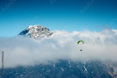 Paragliding in the alps over the clouds Canvas Print