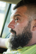 Attractive Man In Good Car. Man With A Beard In A Car. A Man With A Beard In A Car Is Not Driving. The Guy Is A Passenger In The Car In The Front Seat. Portrait Of A Man. Do Not Distract The Driver