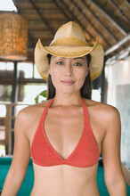 Portrait Of Woman In Bikini Top And Cowboy Hat