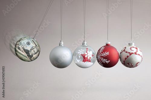 Fotografia Money bauble collision balls concept