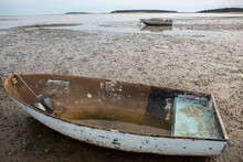 Two Wooden Boats On Beach At Low Tide In Wellfleet, MA On Cape Cod