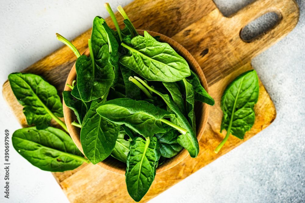 Fototapeta Organic food concept with fresh spinach