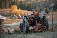 An Old Broken Tractor Slept In The Middle Of The Street, Covered With A Thin Layer Of Shiny Crystals Of Frost, Spreading Its Simple Iron Belongings Around The Neighborhood.