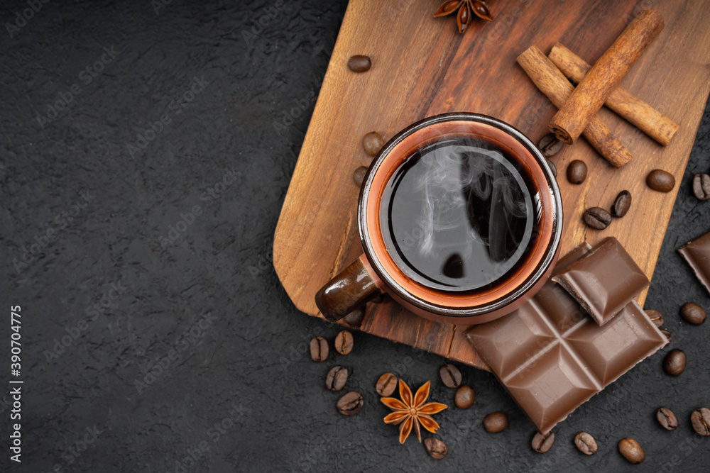 Fototapeta Cup of coffee , coffee beans, chocolate  and cinnamon on black background