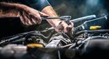 Fototapeta Paryż - Auto mechanic working in garage. Repair service.