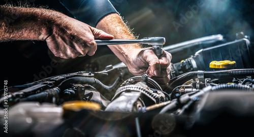 Obraz na płótnie Auto mechanic working in garage. Repair service.