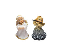 Angel Figurines Of A Girl With A Flute And A Boy Isolated On A White Background