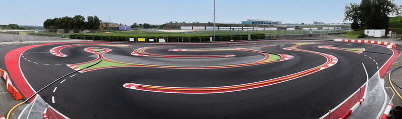 Panoramic view of full motor sport game circuit for models racing track turn and curb