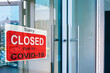 Business center closed due to COVID-19, sign with sorry in door window. Stores, restaurants, offices, other public places temporarily closed during coronavirus pandemic. Economy hit by corona virus