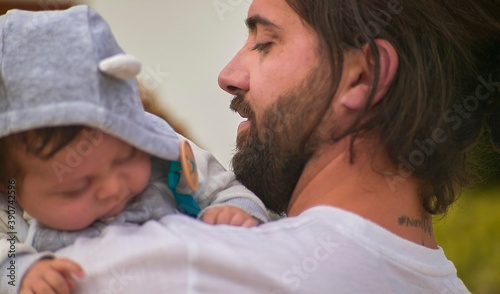 Leinwand Poster Tenderness between dad and infant