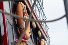 Orange Round Lifebuoys On The Ship
