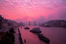 Vibrant, Dramatic Altocumulus Sunrise Clouds And Fog Above Tower Bridge And The River Thames In London, England