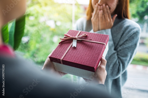 Fotografie, Obraz A boyfriend surprising and giving his girlfriend a gift box
