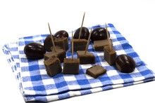 High Angle Shot Of Chestnut Cake And Chestnuts On A Blue Checkered Table Napkin