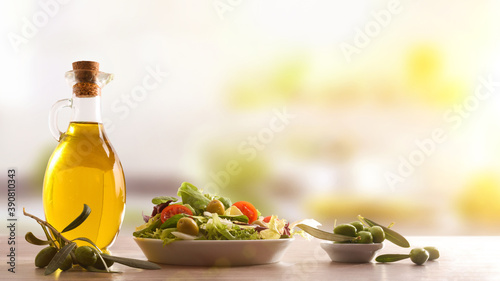 Fotografie, Obraz Mediterranean gastronomy with fresh vegetable salad and olive oil kitchen