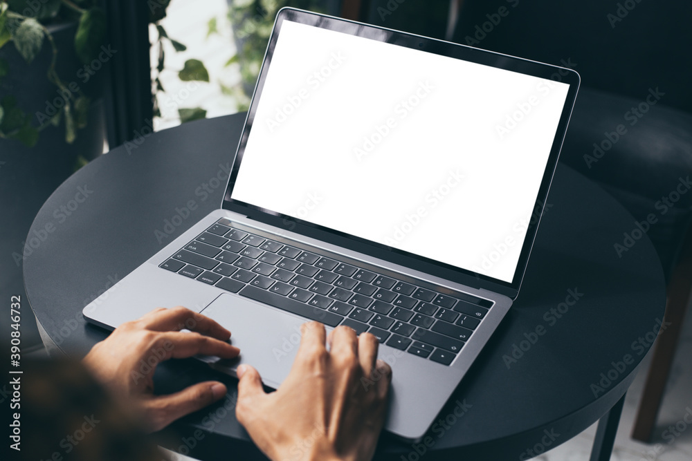 Fototapeta computer blank screen mockup.hand woman work using laptop with white background for advertising,contact business search information on desk at coffee shop.marketing and creative design