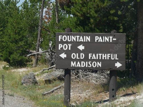 Fotografie, Tablou Directional wooden sign with arrows pointing to the directions to the Fountain Paint Pot, Old Faithful and Madison at Yellowstone National Park
