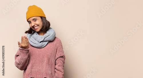 Fotografie, Obraz young woman looking goofy and funny with a silly cross-eyed expression, joking a