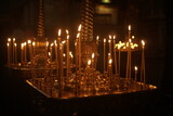 candles burning on a candlestick in the church