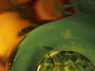Abstract photography. Multi-colored circles on a multi-colored background. Red, yellow, pink, green, purple circles. Drops of oil on the water. Bokeh. The background