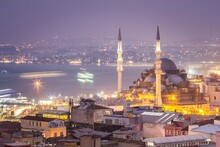 Night Cityscape Of Istambul And The Yeni Cami (New Mosque), Situated On The Golden Horn, At The Southern End Of The Galata Bridge. It's One Of The Famous Architectural Landmarks Of Istanbul. Turkey.