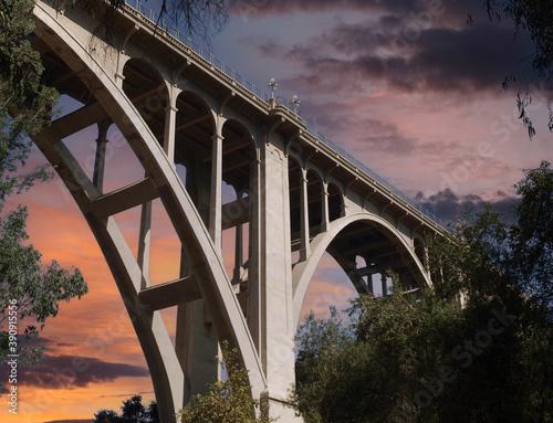Leinwand Poster Historic Colorado Boulevard Bridge in Pasadena California with sunset sky