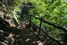 View Of A Steep Pathway To A Mountain With A Wooden Railings