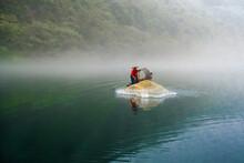 Person In Kayak Cast Fishing Net