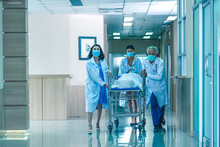 Rear View Of Doctors Running F...