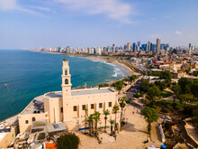 Tel Aviv - Jaffa, View From Above. Modern City With Skyscrapers And The Old City. Bird's-eye View. Israel, The Middle East. Aerial Photography. Sea, Skyline And Blue Cloudless Sky. High Quality Photo