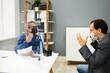Leinwandbild Motiv Angry Business Man Fighting At Work