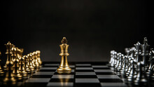 King Golden Chess Standing Confront Of The Silver Chess Team To Challenge On Chess Board. Concept Of Business Team And Strategic Plan, Leader And Strategy Of Risk Management.