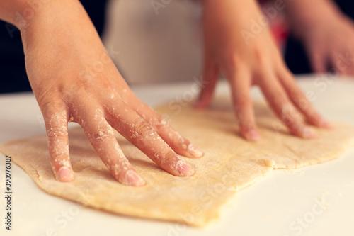 Papel de parede Close up of child doing dough for dessert on christmas day
