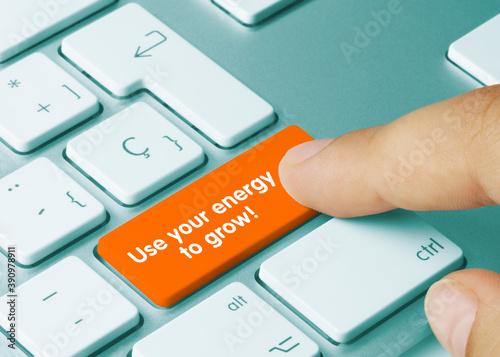Use your energy to grow! - Inscription on Orange Keyboard Key.