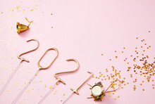 New Year 2021 Golden Numbers 2021 With Shiny Golden Stars On A Pink Background