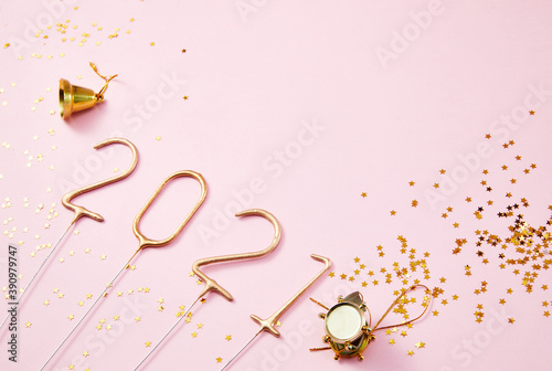 Fototapeta New Year 2021 Golden numbers 2021 with shiny golden stars on a pink background