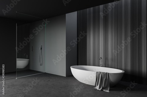 Gray and wooden bathroom corner with tub and shower Fototapete