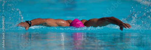 Fotografie, Obraz Swim competition swimmer athlete doing butterfly stroke in swimming pool