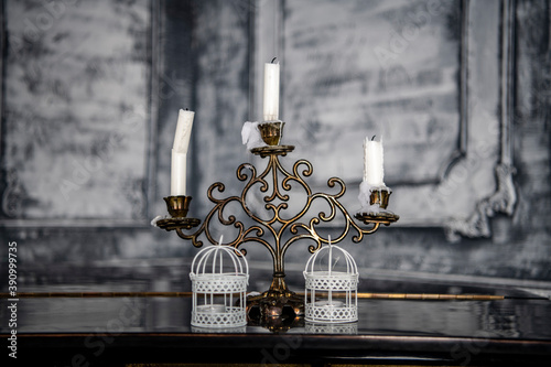 antique candlestick with candles in a large gray hall Canvas Print