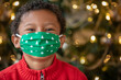 Leinwandbild Motiv Adorable Black Boy Wearing a Christmas COVID-19 Cloth Face Mask Smiling with His Eyes