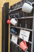 Mugs Hanging On A Outside Fence