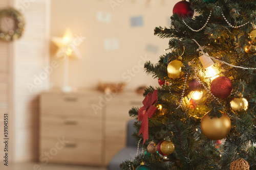 Fototapeta Background image of beautiful Christmas tree decorated with golden baulbs in coz