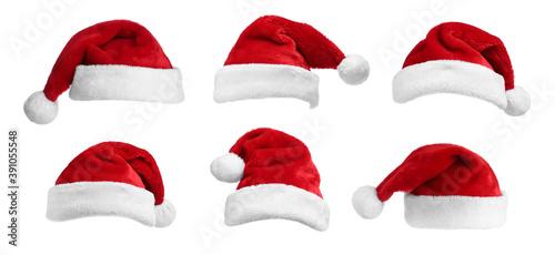 Obraz Set of red Santa hats on white background. banner deisgn - fototapety do salonu