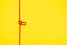 Butterfly Loop Knot With Red Climbing Rope On Yellow Background